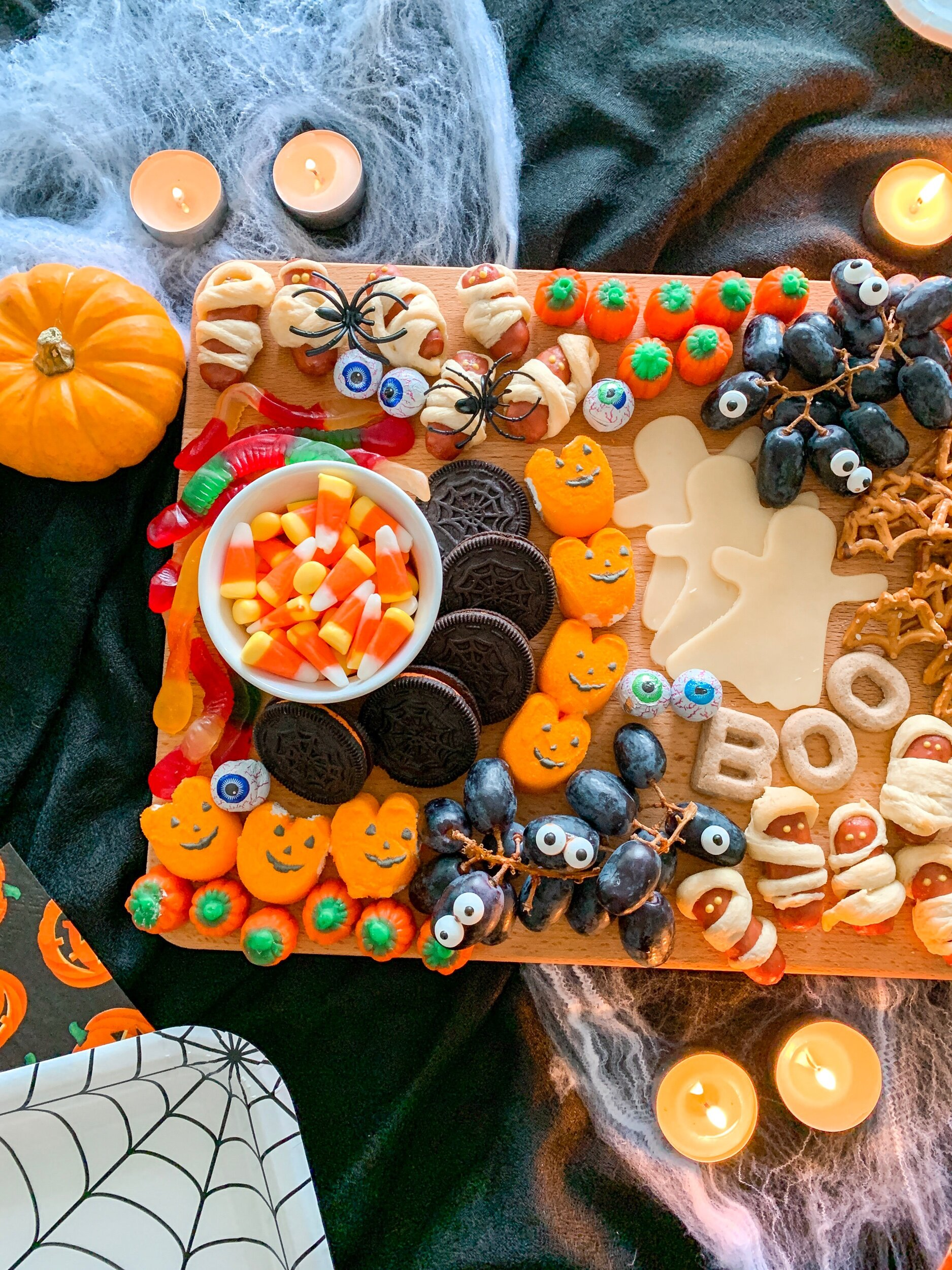 My favorite touch for a Halloween themed charcuterie board? Add candy eyes for a fun, monster-like feel to any treat!