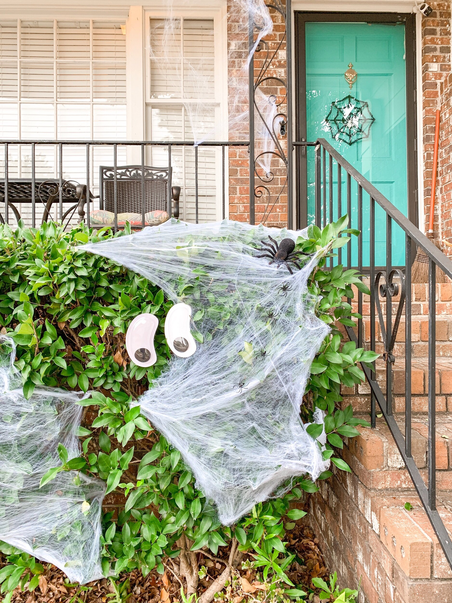 Glow in the dark googly eyes, spider webbing with little spiders, large fuzzy spider and spider door wreath are all affordable Halloween decorations from the Dollar Tree!!