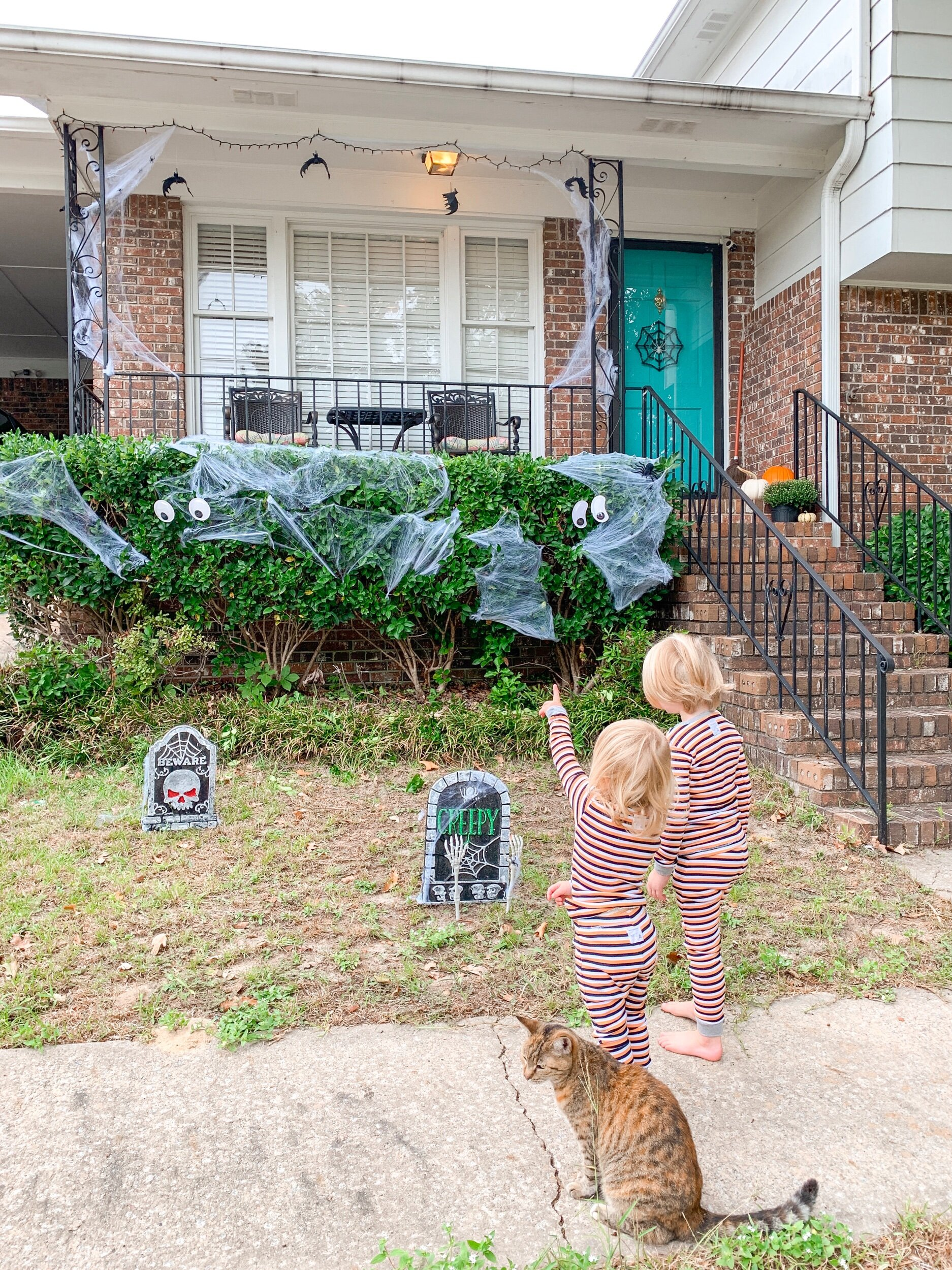 My kids LOVE these Halloween decorations. They don't care that they're only $1. They don't mind that I only spent $13 on this whole spooky, graveyard display. And you certainly won't see me complaining about it!