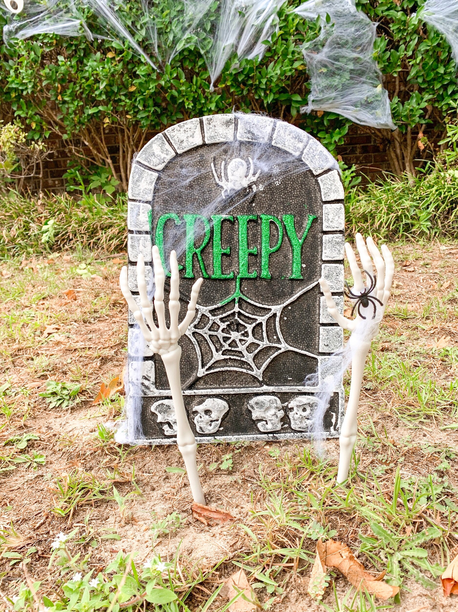 """Styrofoam gravestone, skeleton """"tongs"""", spider webbing (with spider rings) all affordable Halloween decorations from the Dollar Tree!!"""
