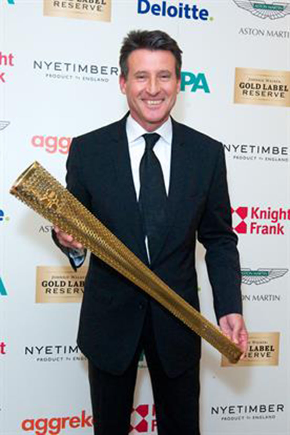 879_14454_Lord Coe and Olympic torch.jpg