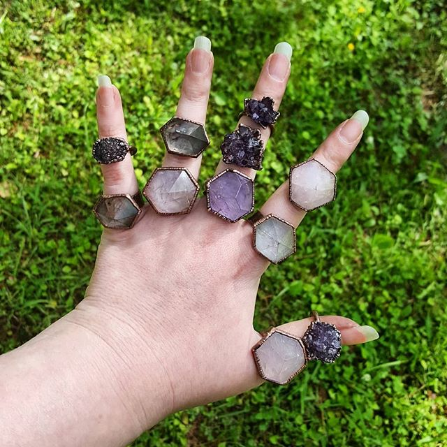 Freshly polished batch of rings completed just in time for tomorrow's night market with @wvhandcraftedcooperative. Which is your favorite??? . . . . . #RoseQuartz #SmokyQuartz #Amethyst #ClearQuartz #quartzpoints #AmethystRose #RoseAmethyst #quartzjewelry #quartzring #quartzrose #CrystalHealingJewelry #crystalporn #crystaljewelry #handfulofmagic #crystalhippie #crystalenergy #Metaphysical