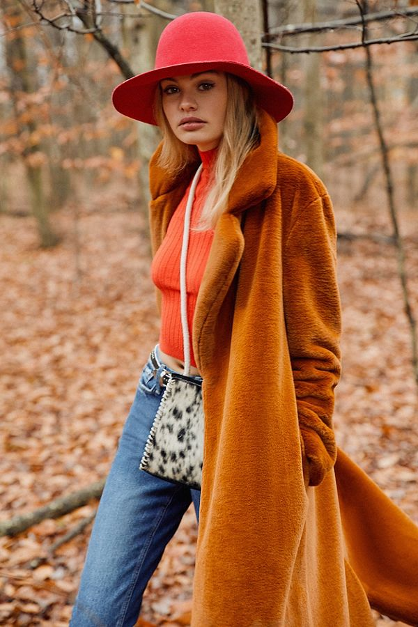 Urban Outfitters  Long Faux Fur Coat $169 in light brown.