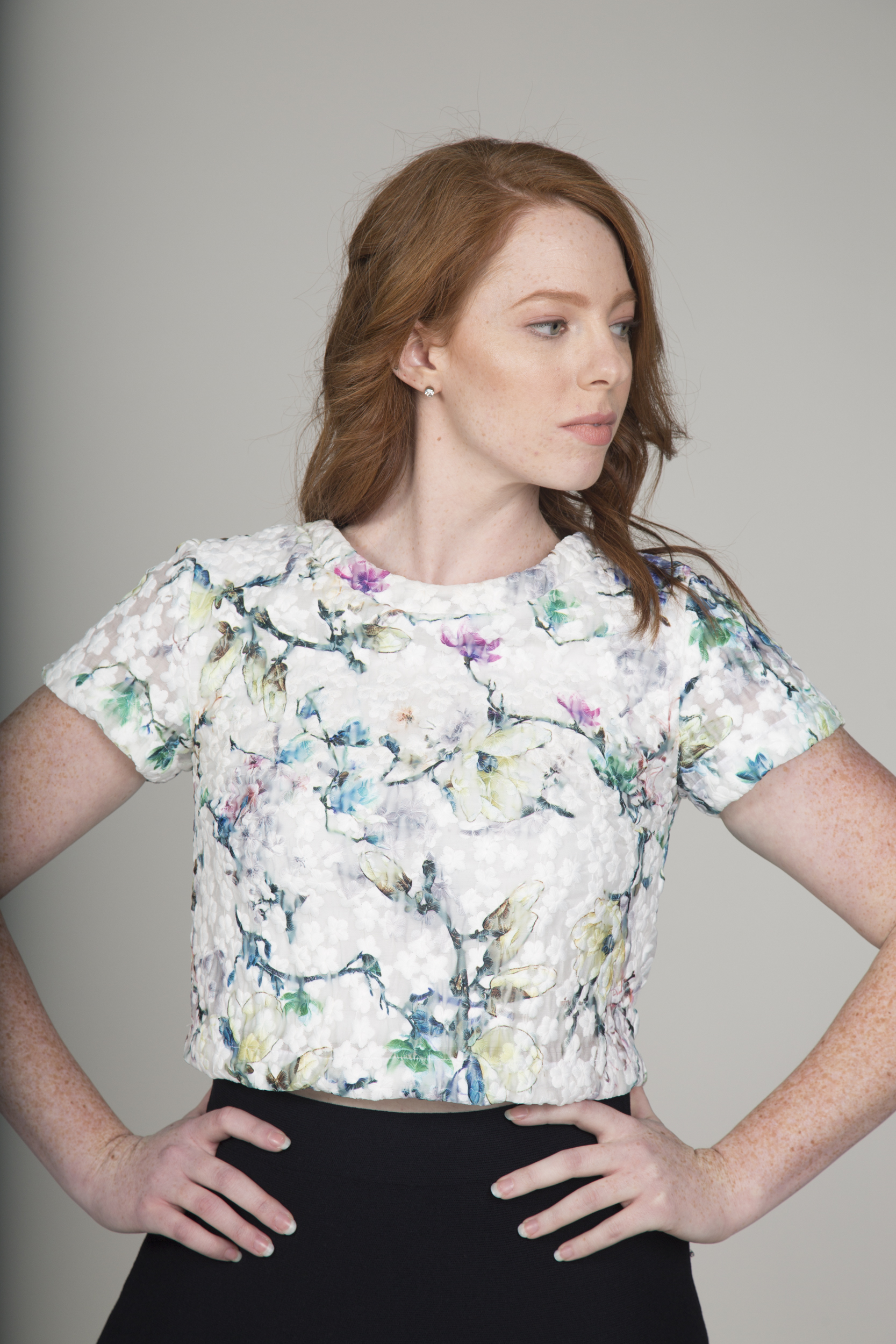 """This is probably one of our most popular items.  The double floral pattern (white embroidered flowers and floral screen print) makes this a statement piece in itself.  Even though it's a crop top by name, it still can be worn with a pair of slacks or a high waisted skirt.  It falls right at the waist line and still can be comfortably worn to a formal event."" -BhavyJ"