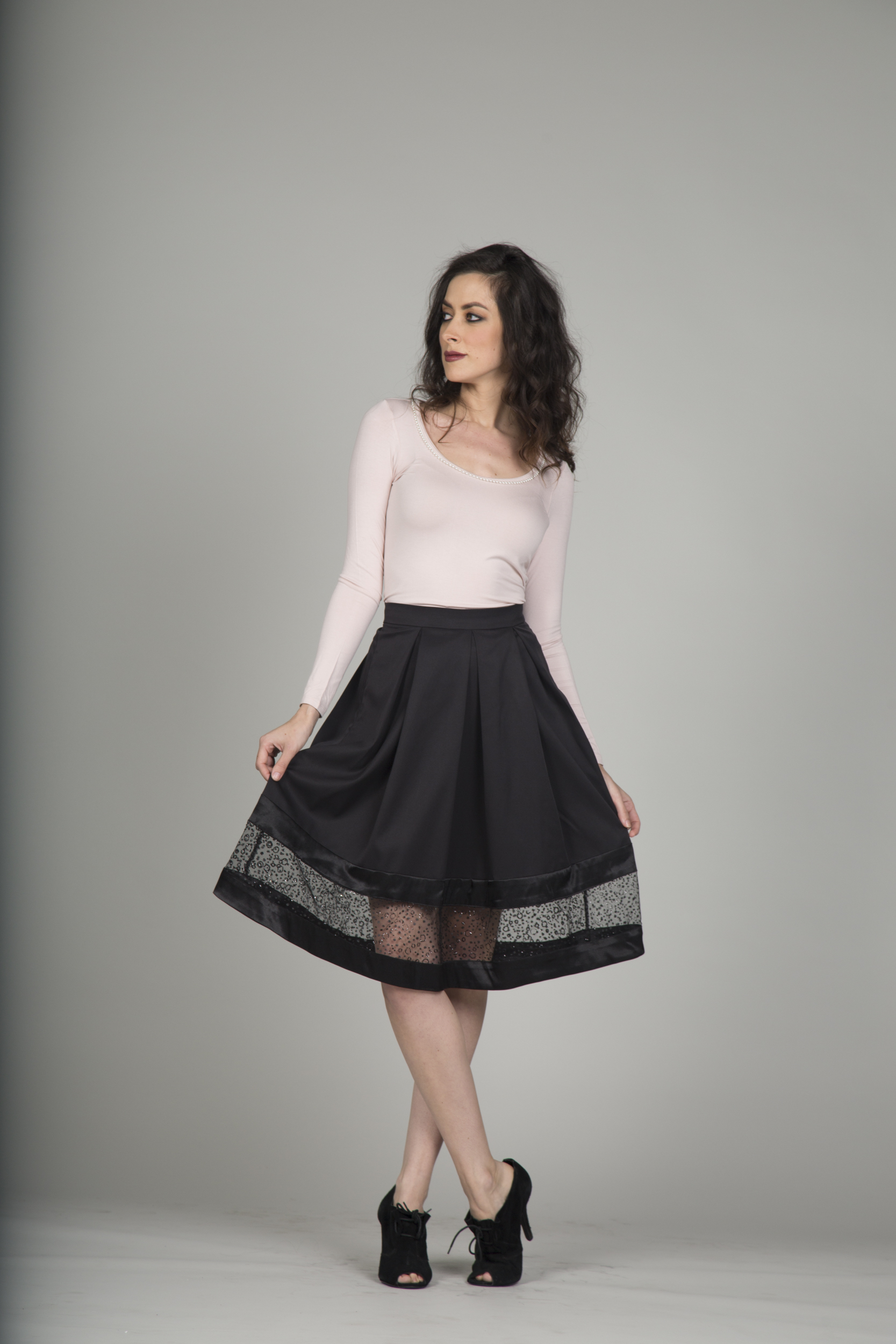"""This is one of my favorite pieces in this formal collection.  There is such a variety of colored tops that can be worn with this skirt.  The pleats give it a structural form and fullness to the skirt.  The patterned tulle border shows just a little bit of leg but still can be worn professionally with leggings or tights."" -BhavyJ"