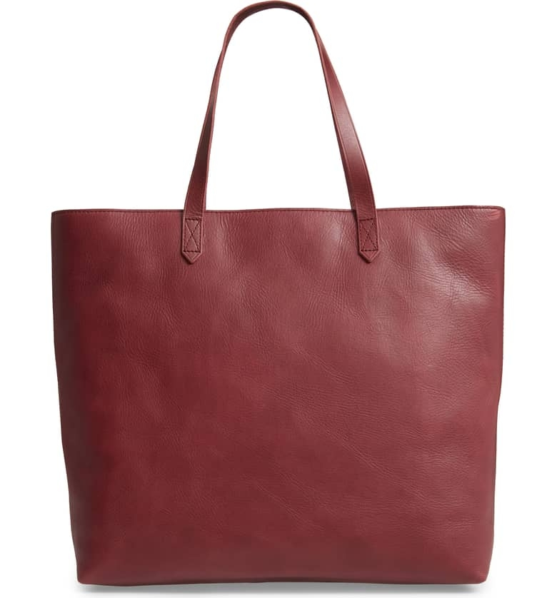 Madewell Zip Top Tote - We have found your perfect tote! This Dark Cabernet color is great for Fall. You can find this amazing tote at Nordstrom's for $188 along with 4 other colors. It can hold up to a 13 inch laptop, water bottle, sneakers for the gym after work, or makeup bag!