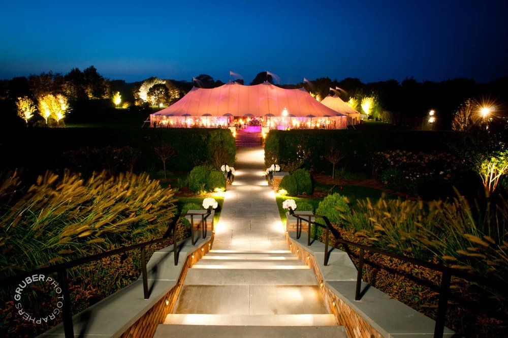 A well lit tent at sunset for guests to dance the night away