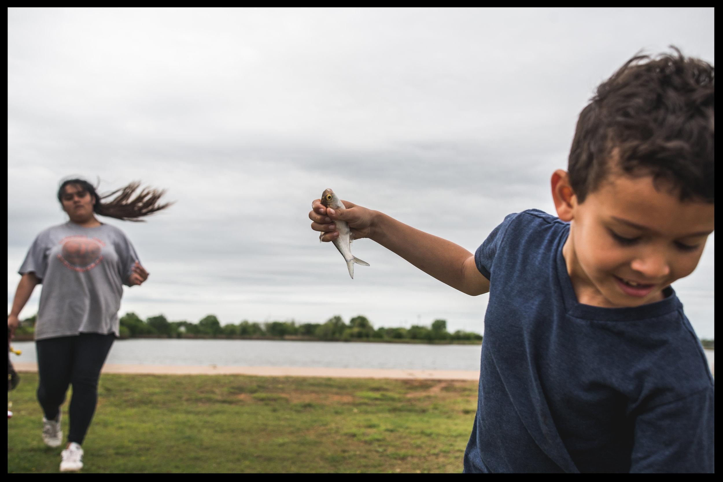 Little boy holding a fish
