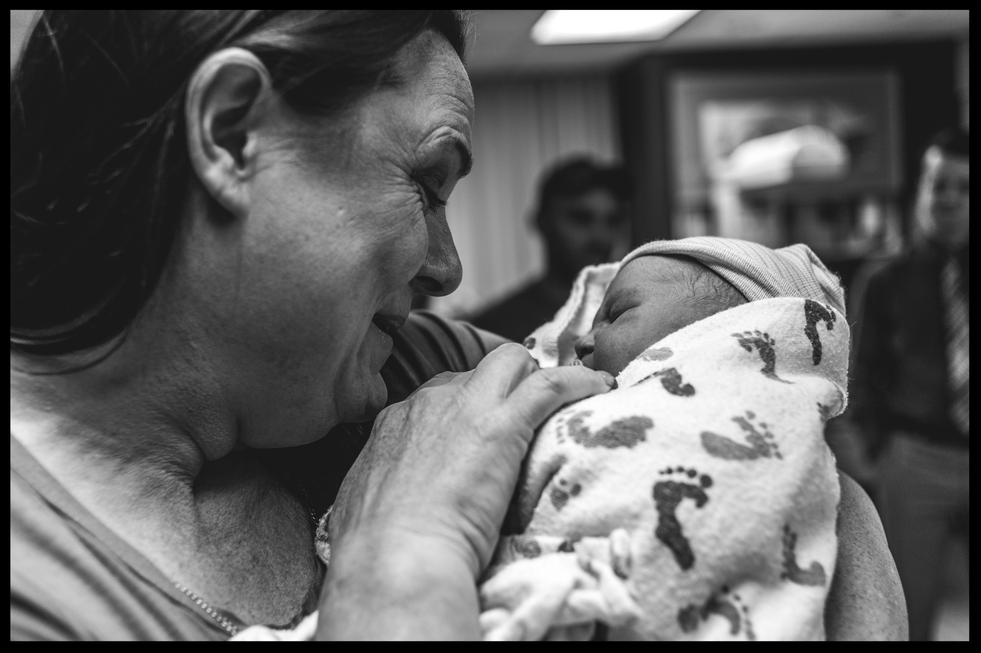 Grandmother holding her new baby granddaugher, black and white, Stillwater, OK