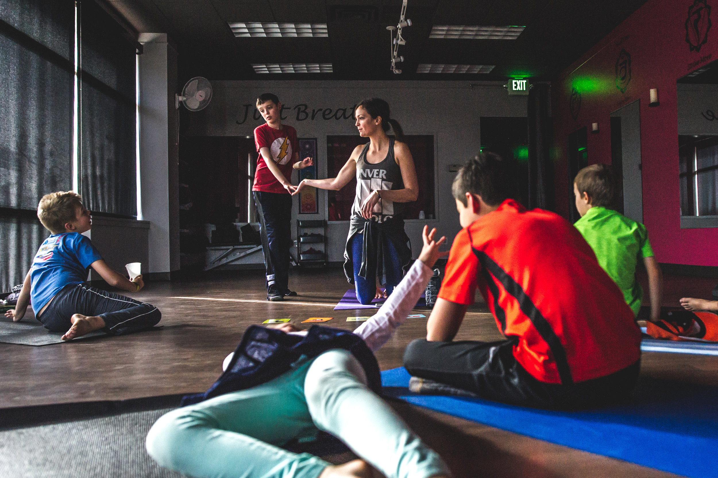 Color photo of children on the autism spectrum taking a yoga class with Spectrum Yoga in Littleton, Colorado