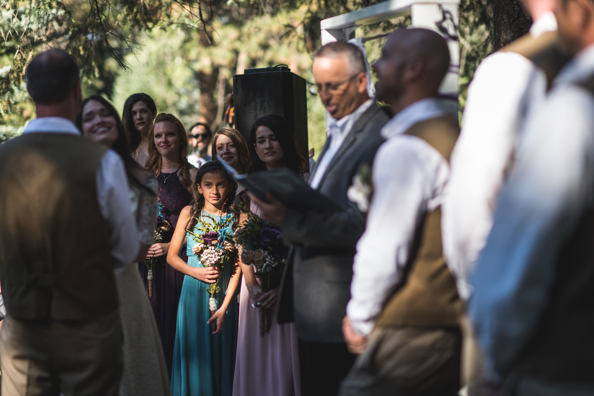 Bridesmaid during an outdoor wedding ceremony in a beautiful pocket of light