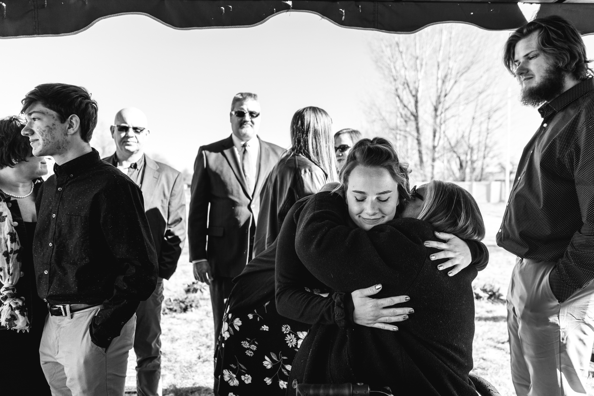 Family members embrace during a funeral service for Barbara Richard in Greeley, Colorado