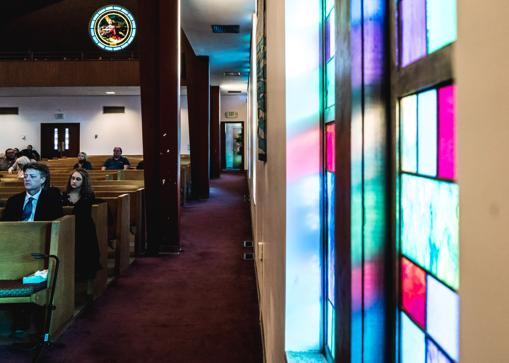 View of the stained glass windows inside the Greeley United Methodist Church in Greeley, Colorado during the memorial service of Barbara Richard