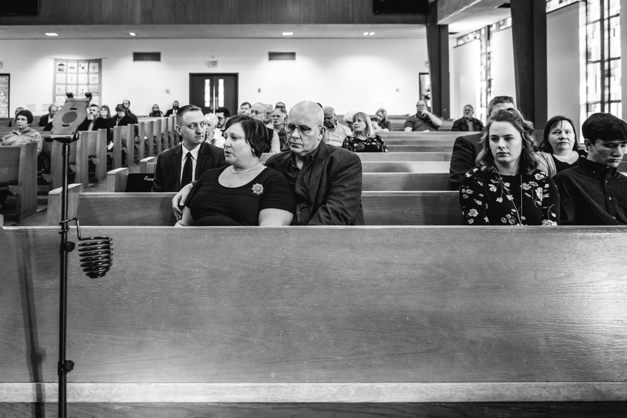 A family in mourning at the United Methodist Church in Greeley, Colorado during the funeral service for their beloved family member and friend