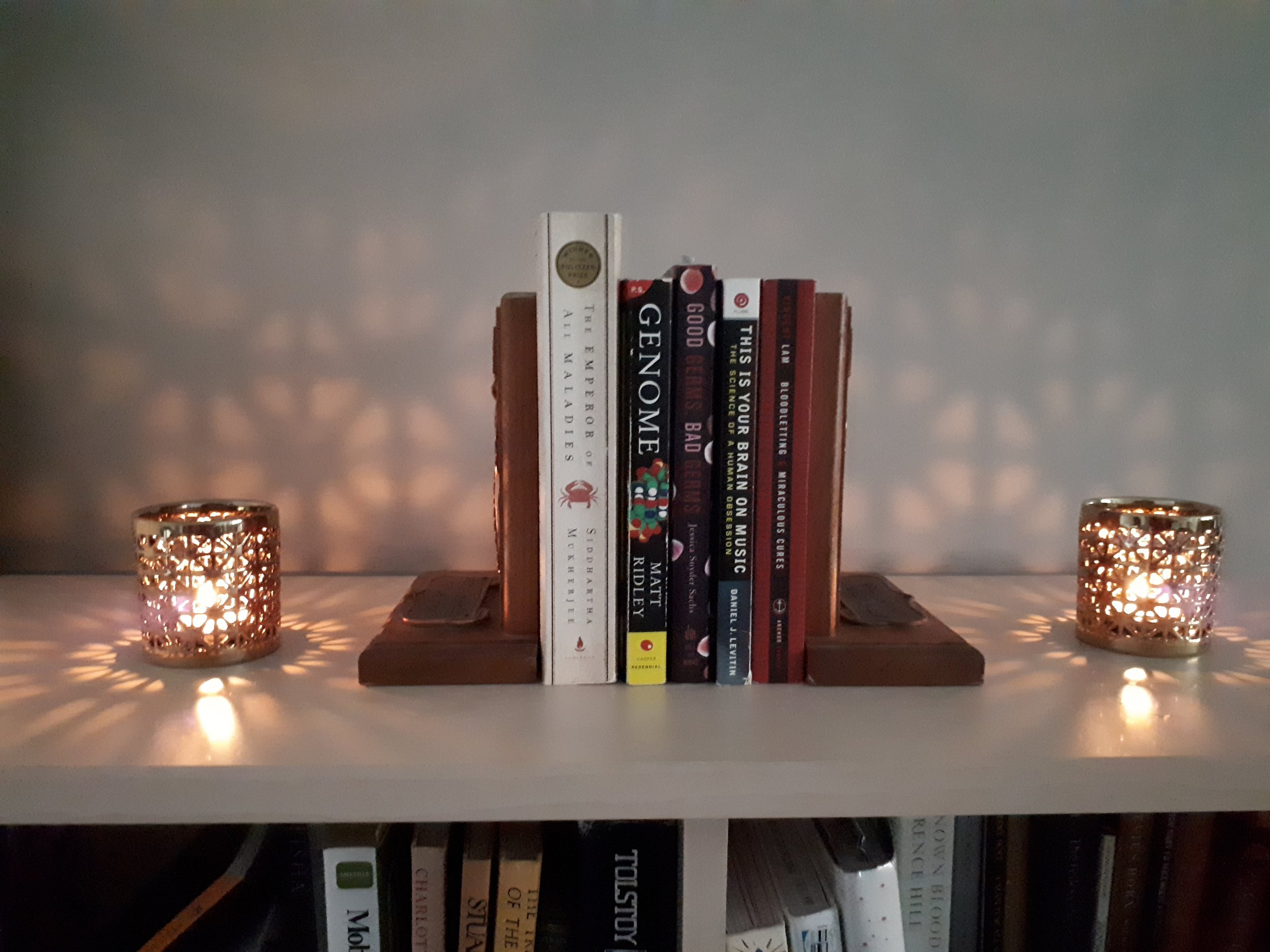 Lighting and candles can also be decorative elements, and placed to help frame things - like books! But not too close to the candles, of course.