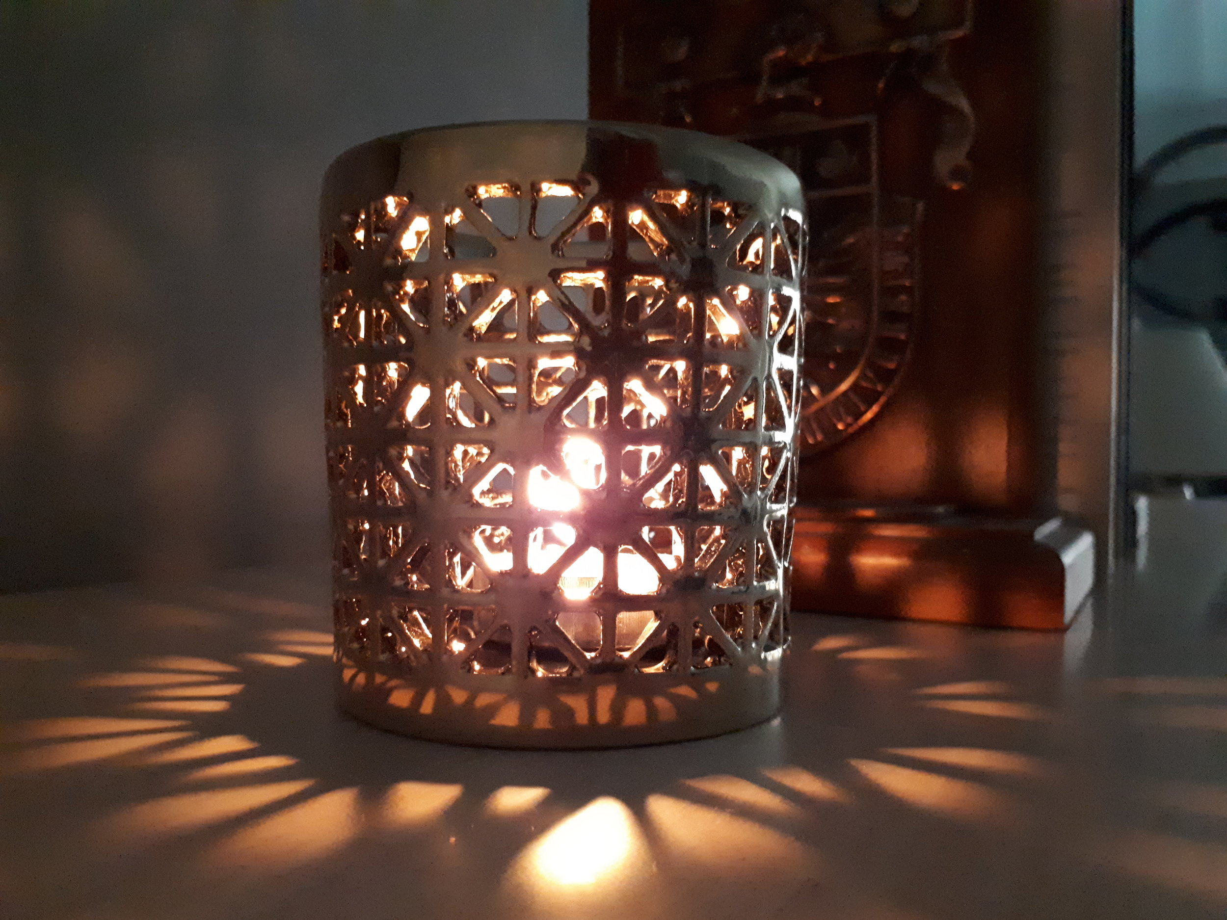 Verdun candle votives generate a beautiful, starry pattern when lit from inside, but are also a stylish, gold accent for every day.