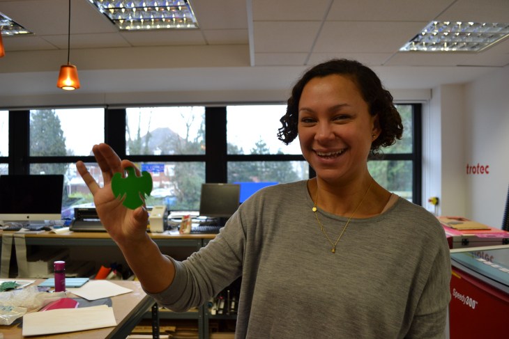 Managing Editor Laura (S) showing off a laser-cut Barclays eagle logo