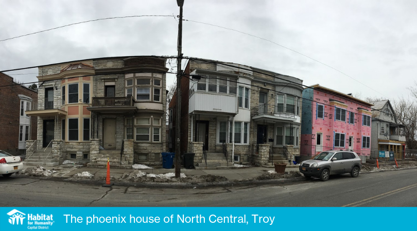 "The ""phoenix house"" is the home on the far left – and those two pink buildings on the right are Habitat houses under construction!"