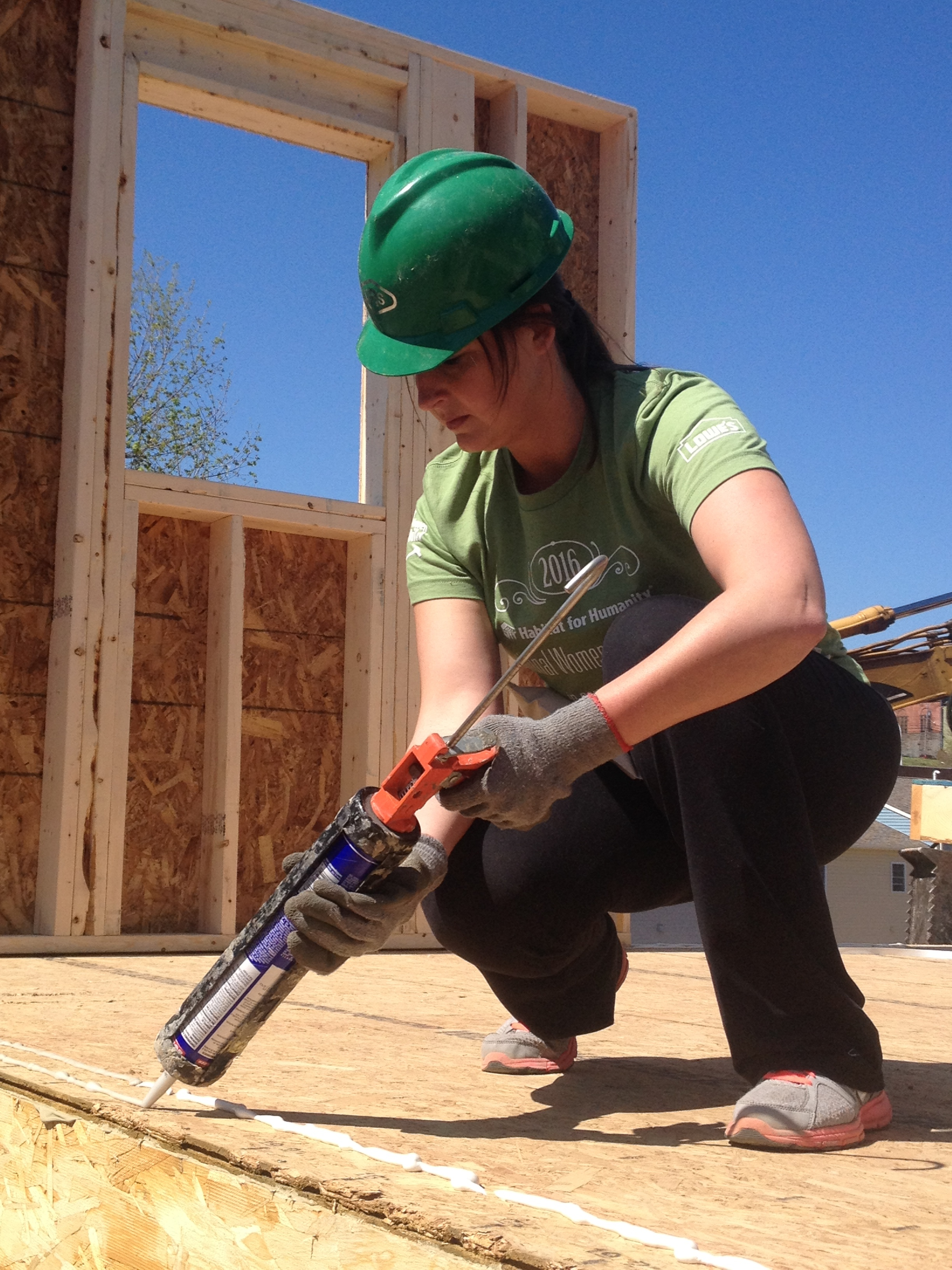 women build 2016 portrait woman caulking.JPG