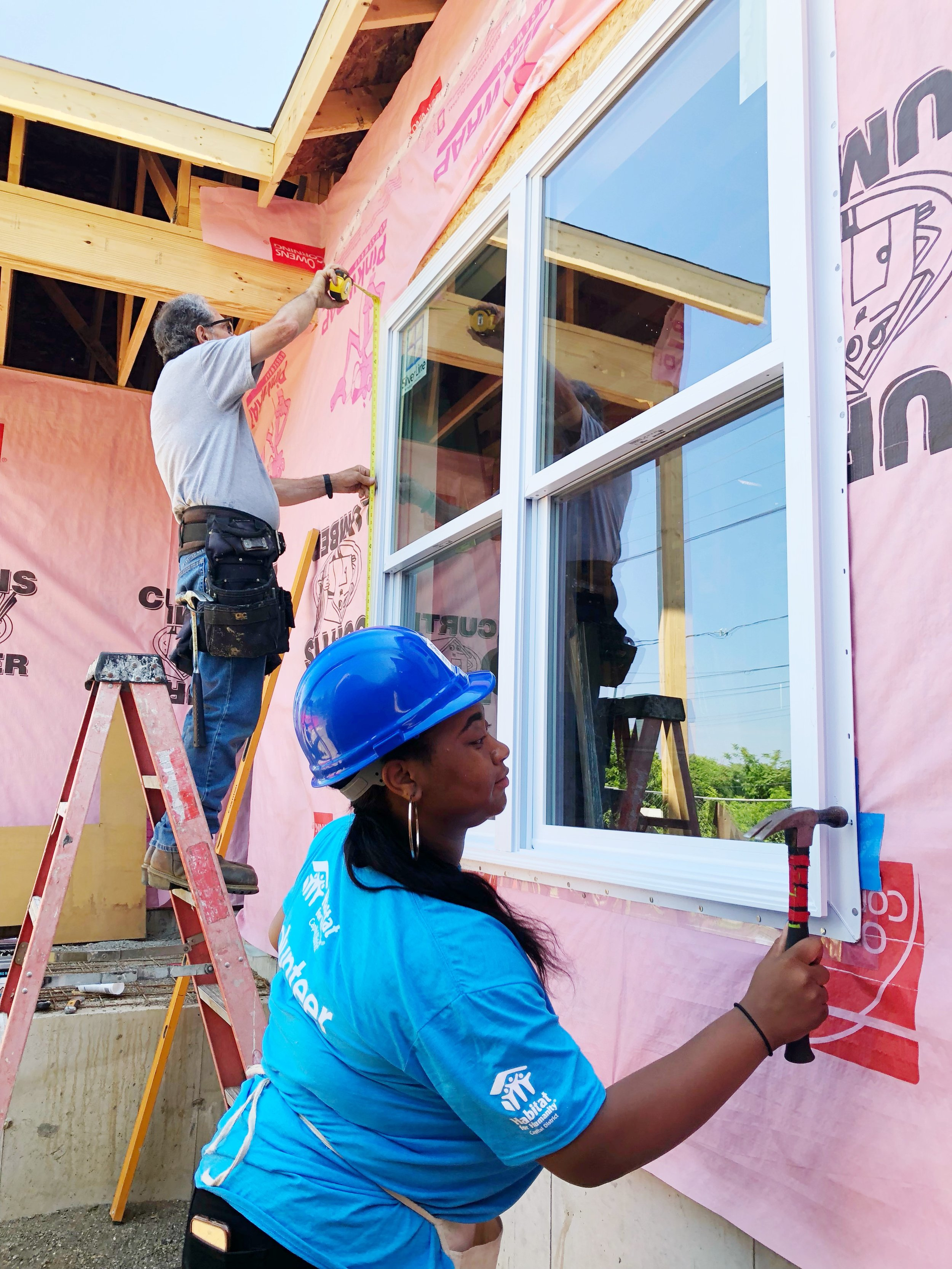 Jasmin on the build site in South Troy, where she helped install five windows.
