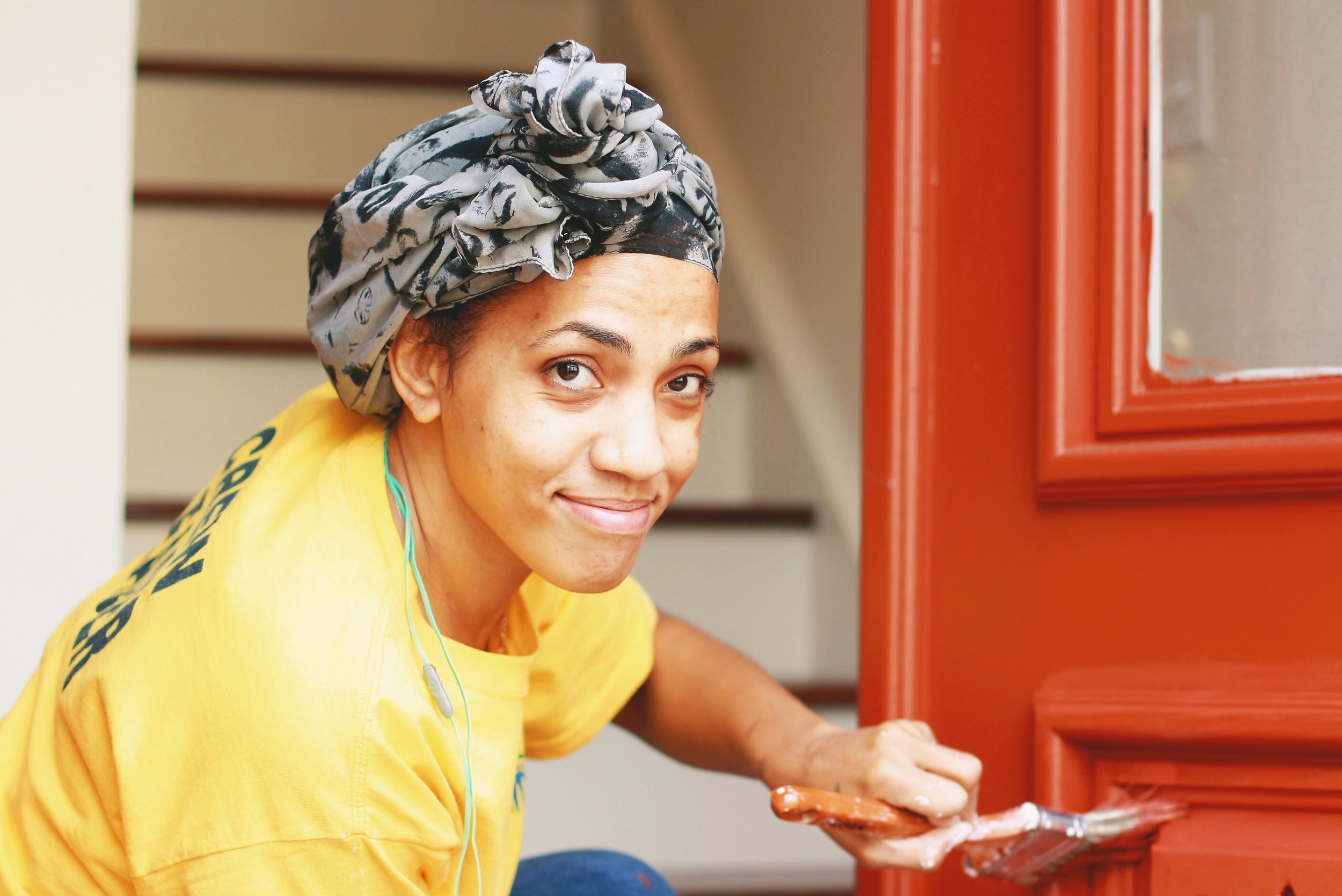 Vanessa painting a door. We love this picture!