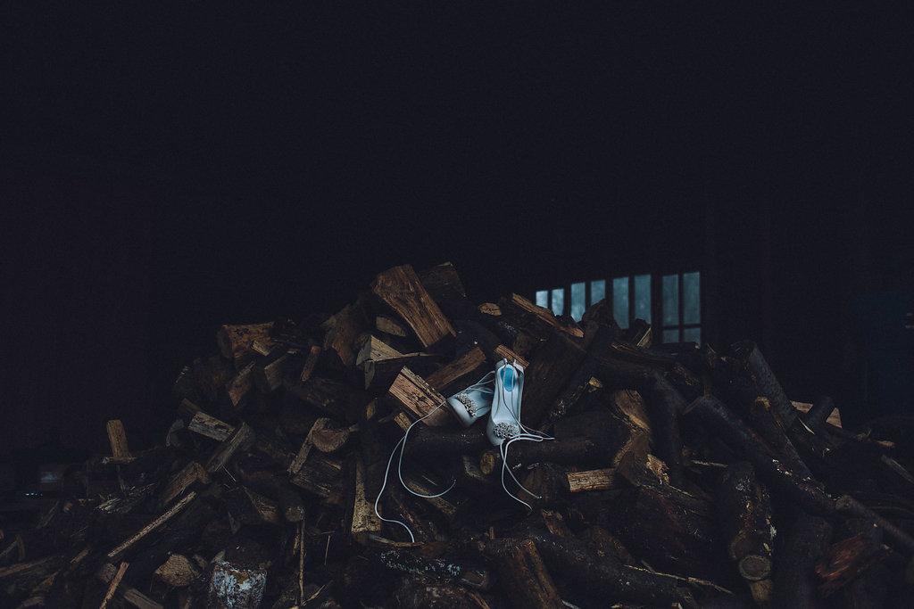 Shoes on Wood Log Stack - Captains Wood Barn Essex