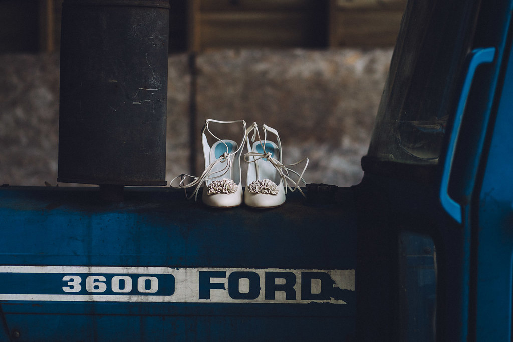 Wedding Shoes on a Tractor - Captains Wood Barn Essex