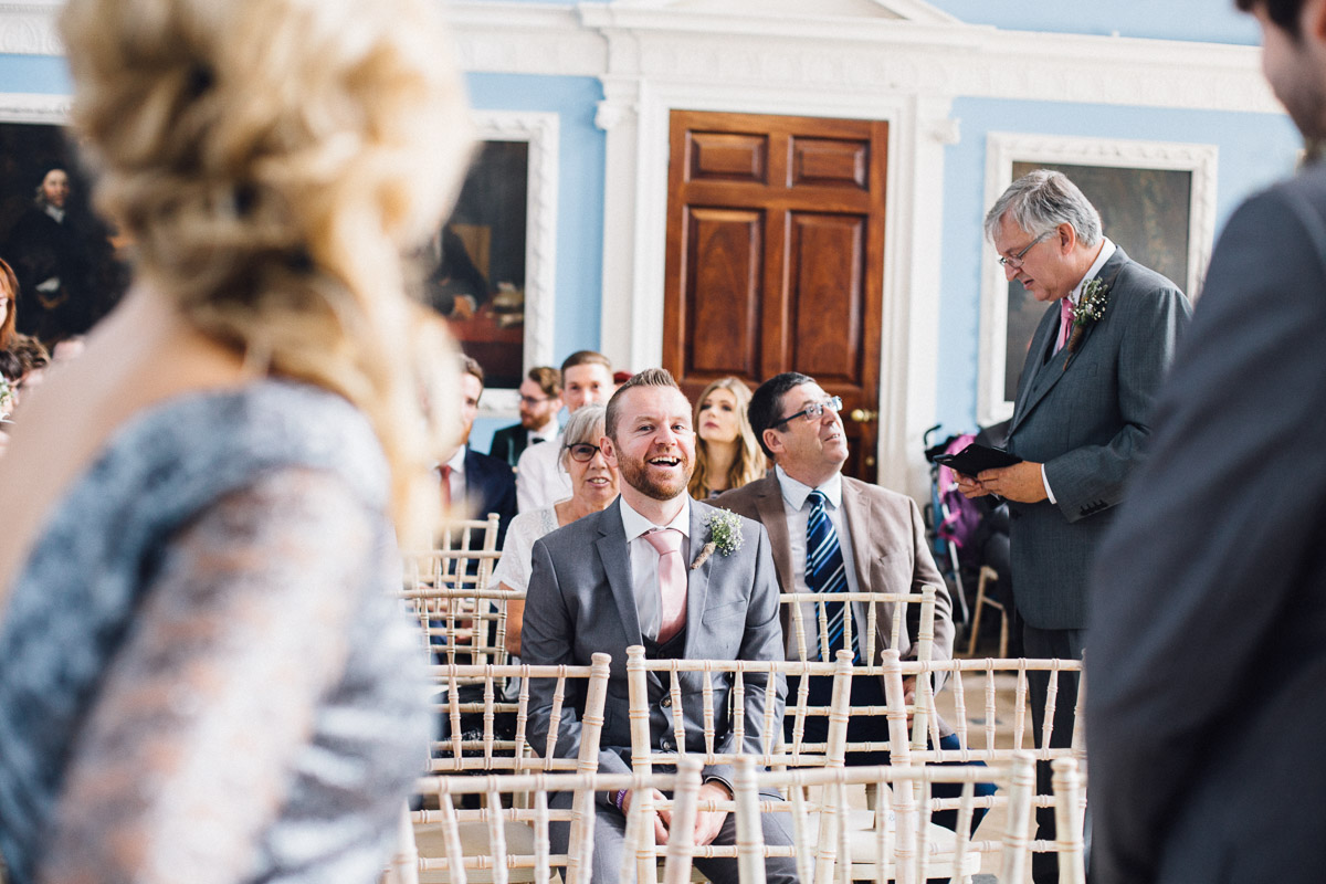 Guests Laughing waiting for Wedding Ceremony