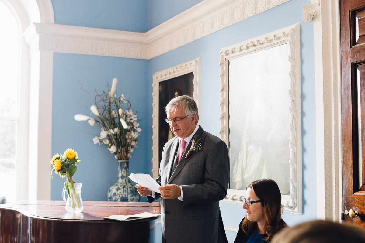 Father of Groom doing Reading During Wedding Ceremony