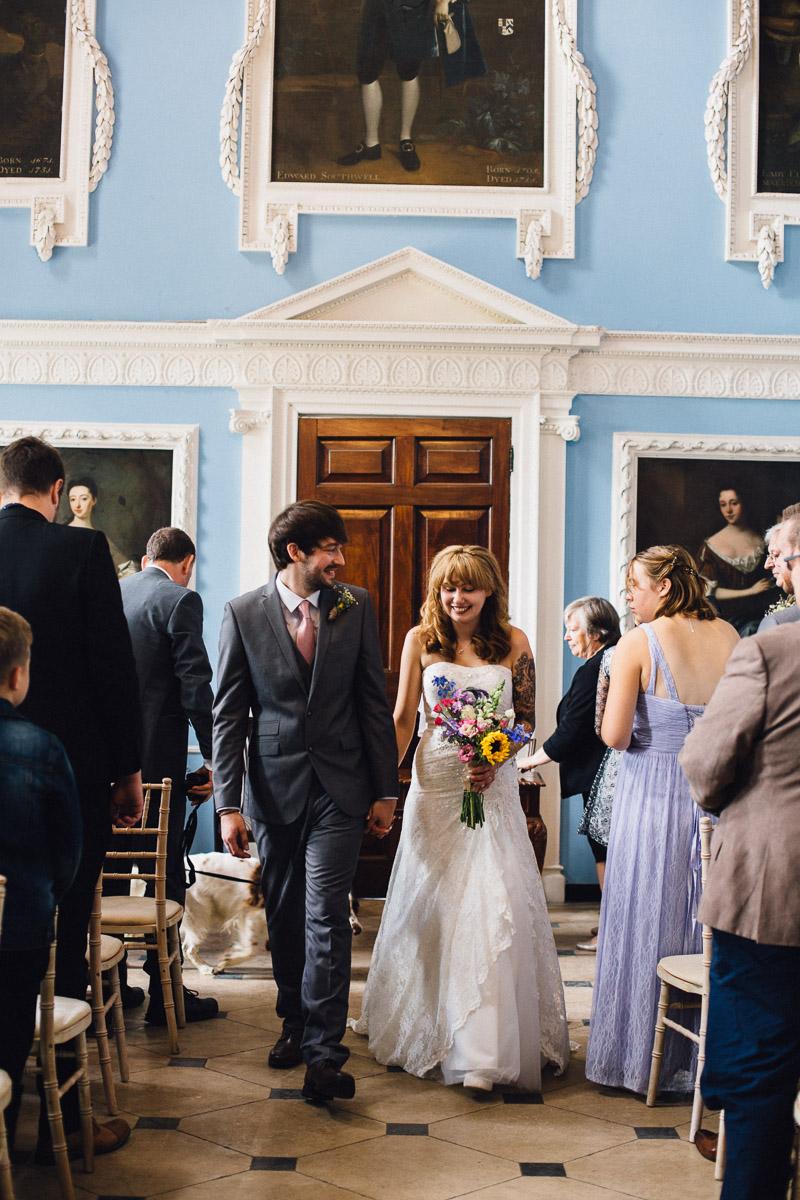 Bride and Groom Walk up Aisle