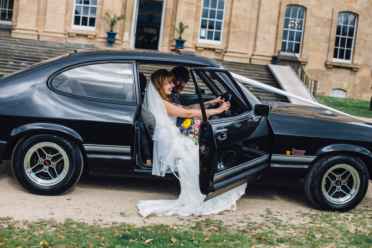 Bride Pretending to Drive Wedding Car