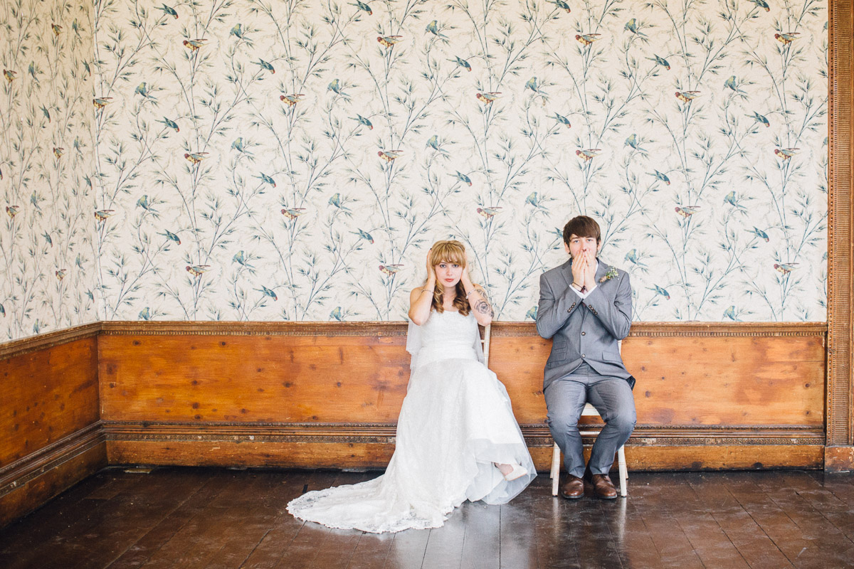 Bride and Groom Cover Faces for Alternative Wedding Photo