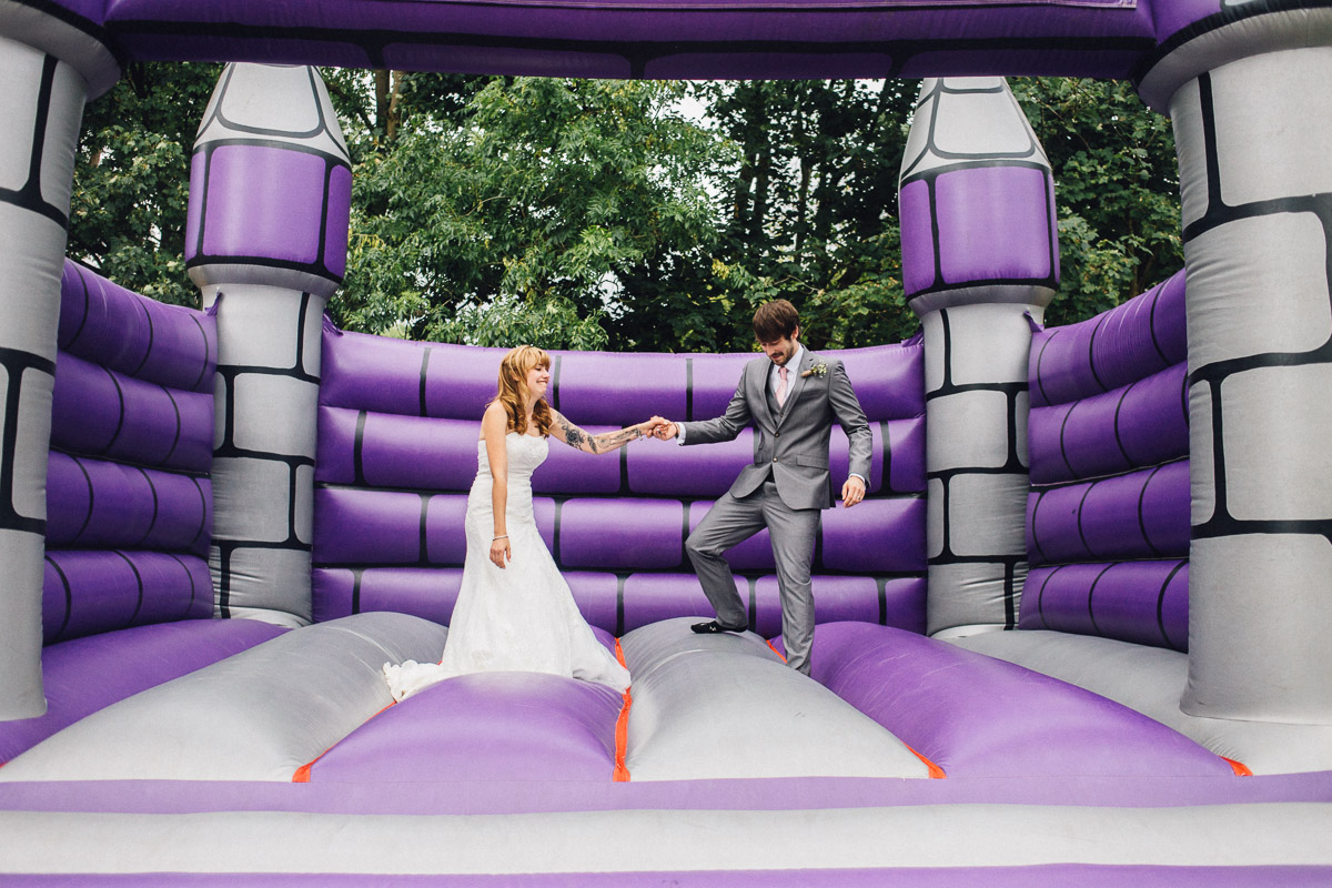 Bride and Groom on Bouncy Castle Fun Wedding