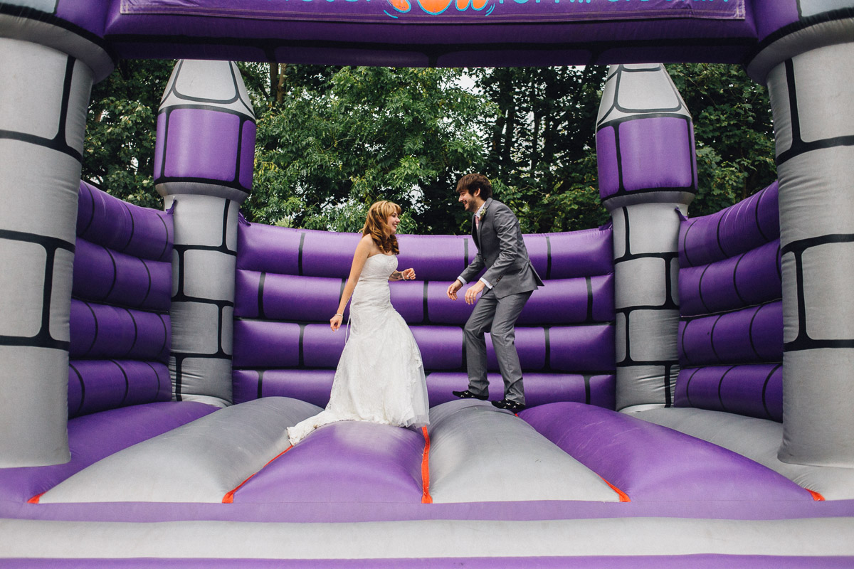 Bride and Groom on Bouncy Castle