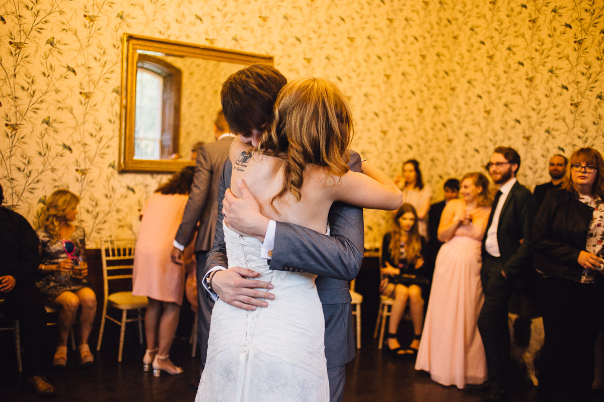 Bride and Groom Hug During First Dance