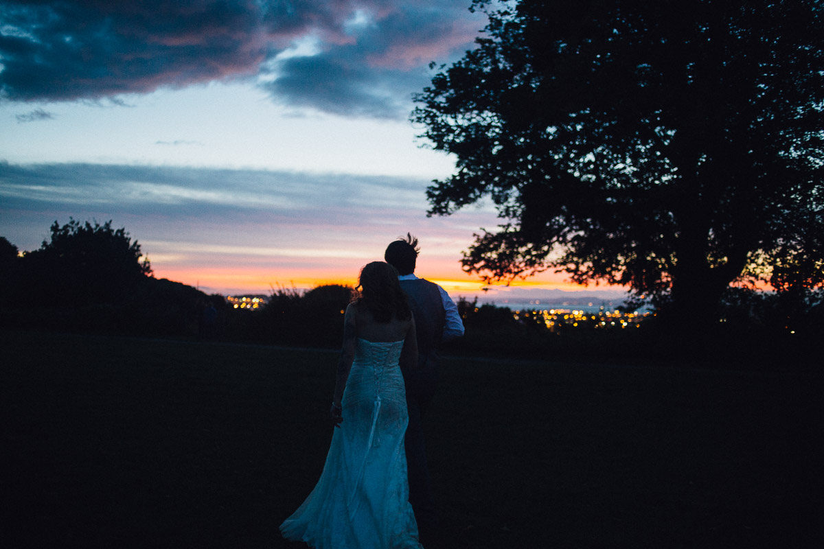 Bride and Groom Watch Sunset