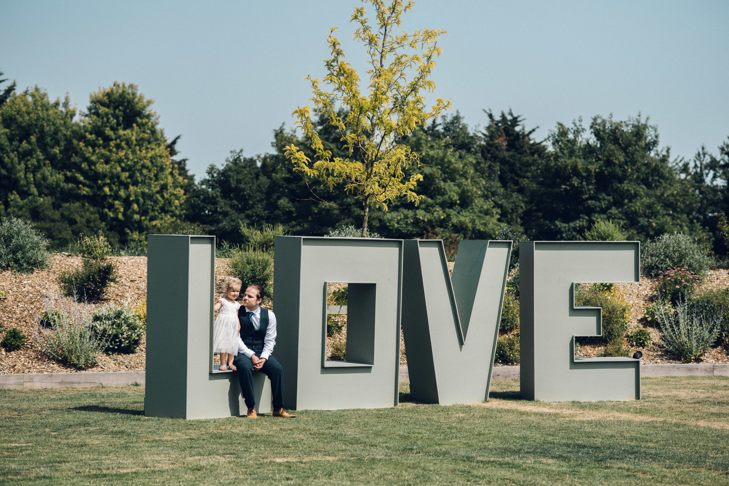 Guests sit on Love Sign