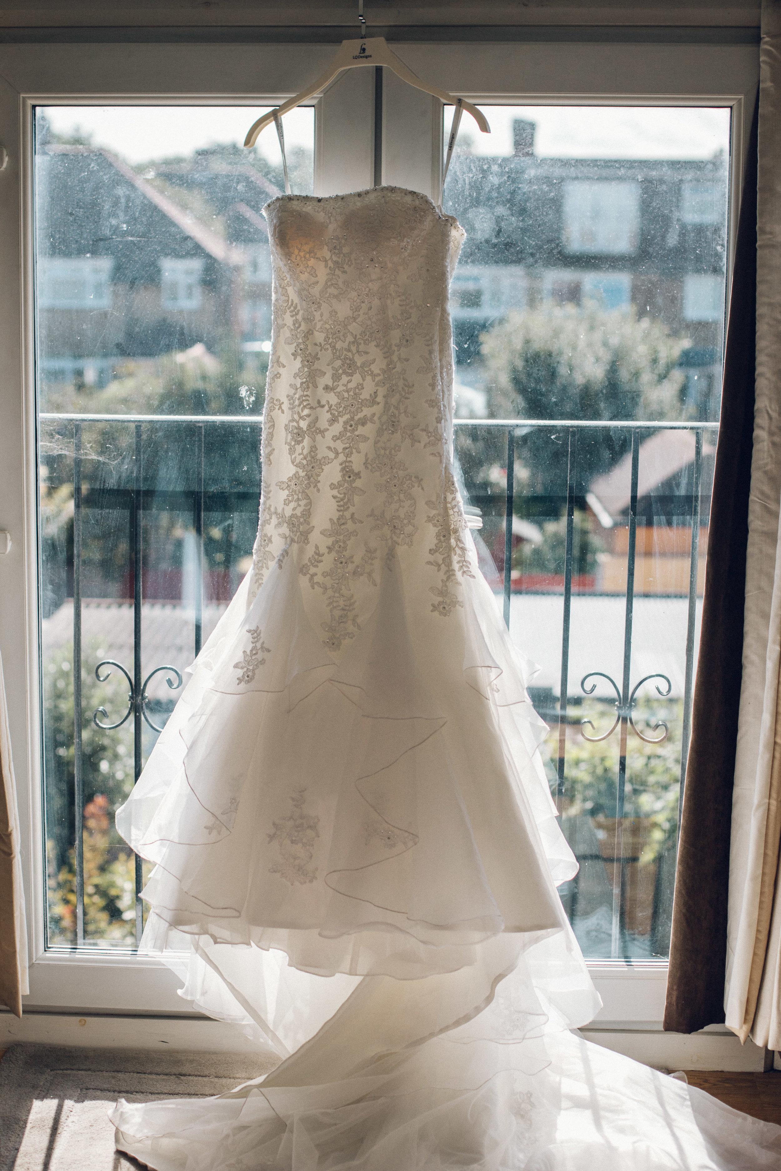 Lace wedding dress hung up