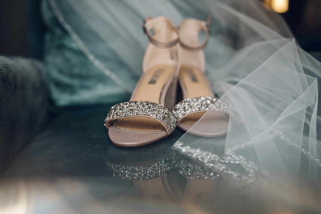 Bridal prep at Raddison Blu, poplar. Shoes and veil on velvet chair