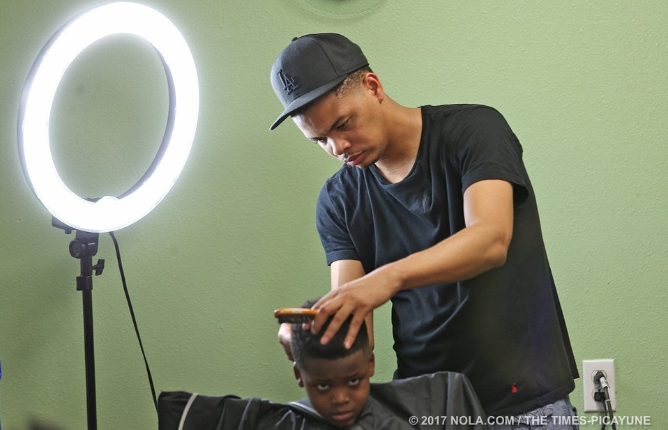 Darrl worked w/Better Tomorrows donating free services to the kids of The Chateau d' Orleans apartment complex. Darrl Robert's barber chair stayed busy-- a nice haircut helps w/esteem he said.