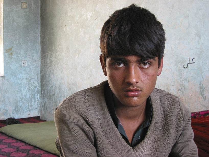 Bahram, the Taliban prisoner boy, in captivity. Northern Afghanistan, 2002