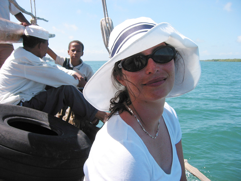 Courtenay wearing her Jackie O. hat, sailing the Indian Ocean. Lamu Island, Kenya