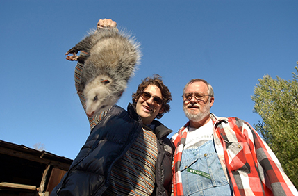 """New York may got its ball. But we got our possum!"" With the guest of honor, right before the annual ""possum drop,"" in Brasstown, North Carolina"