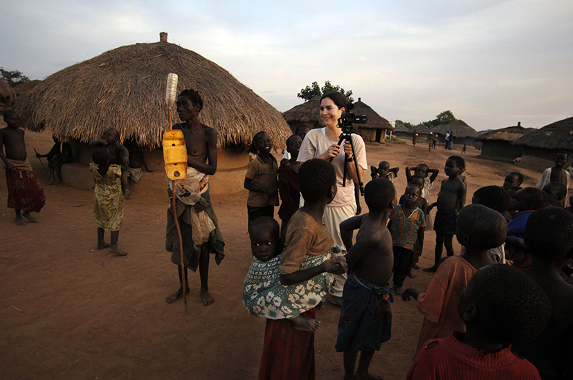 Courtenay filming a Ugandan refugee camp