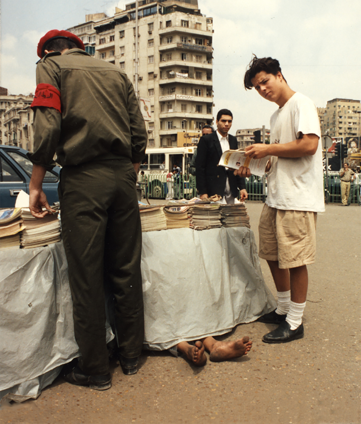 "Roko, Tahir Square, Cairo, during the ""Year On"" in 1992. Notice the stray pair of feet."
