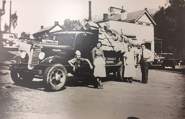 Kegs and cases of beer on the road to delivery in Wilmerding, PA, Dangelo Distributing (now  B  rentwood Distributing ), 1930's