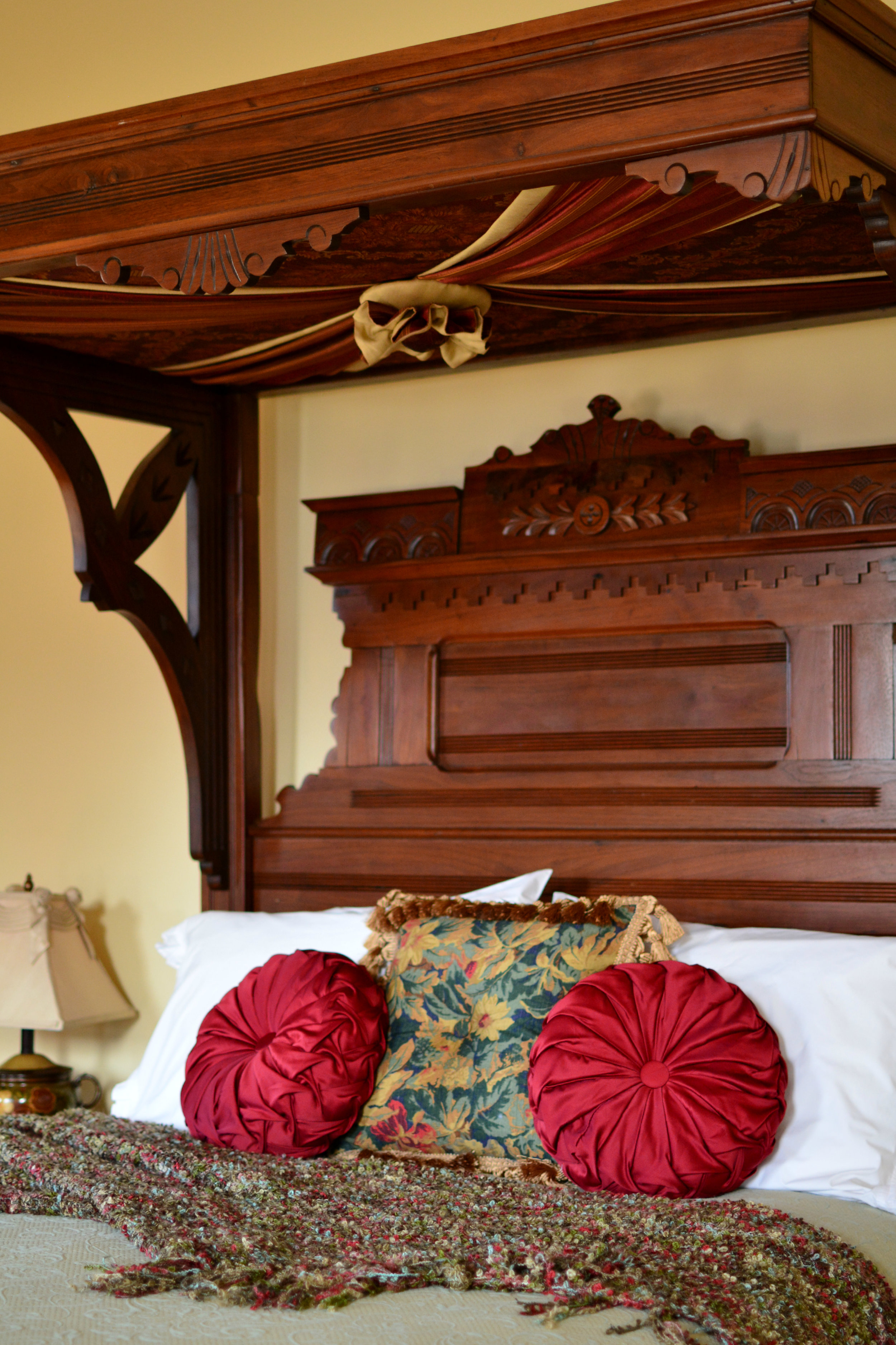 Eastlake Room - with a romantic walnut queen-size antique canopy bed?