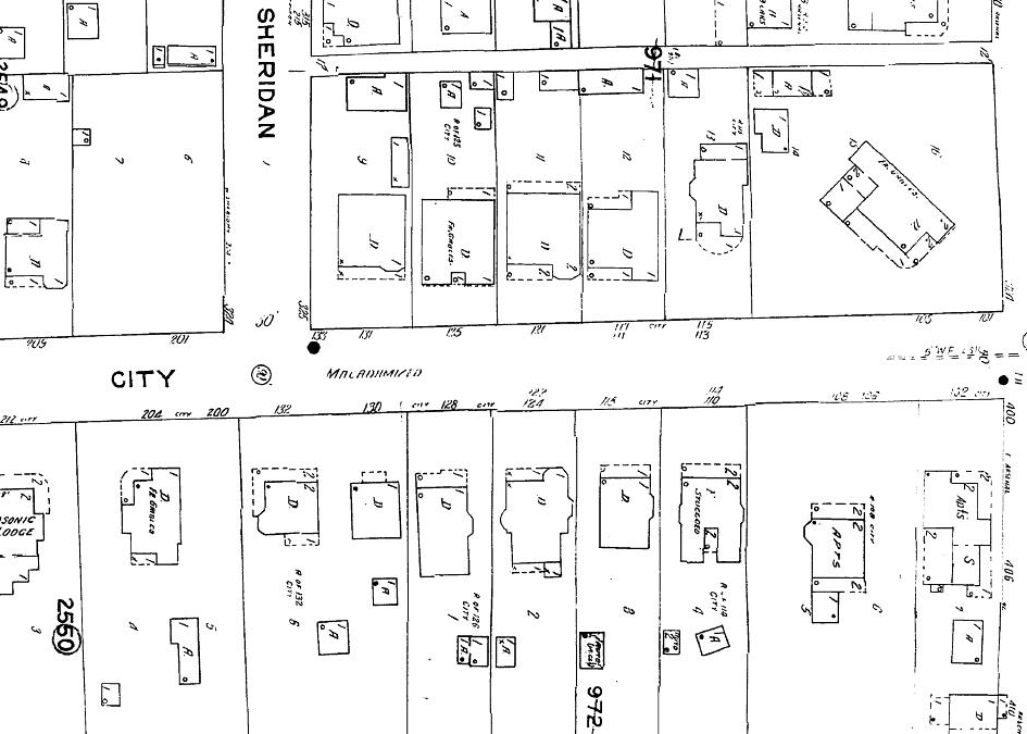 Sanborn Insurance Maps indicated roofing material in the corners of each structure.