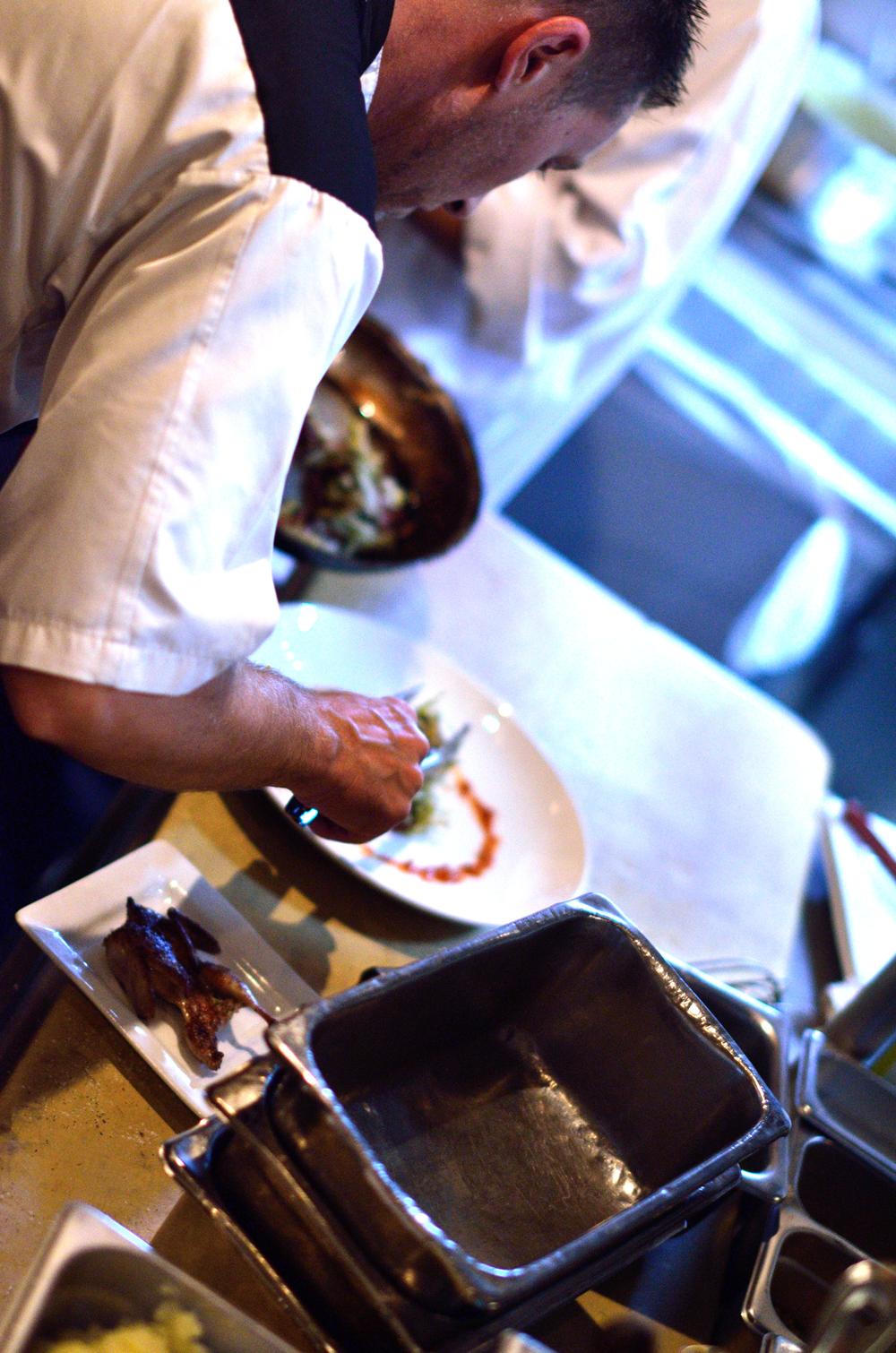 Parkway Grill Cef preparing scallop entrée