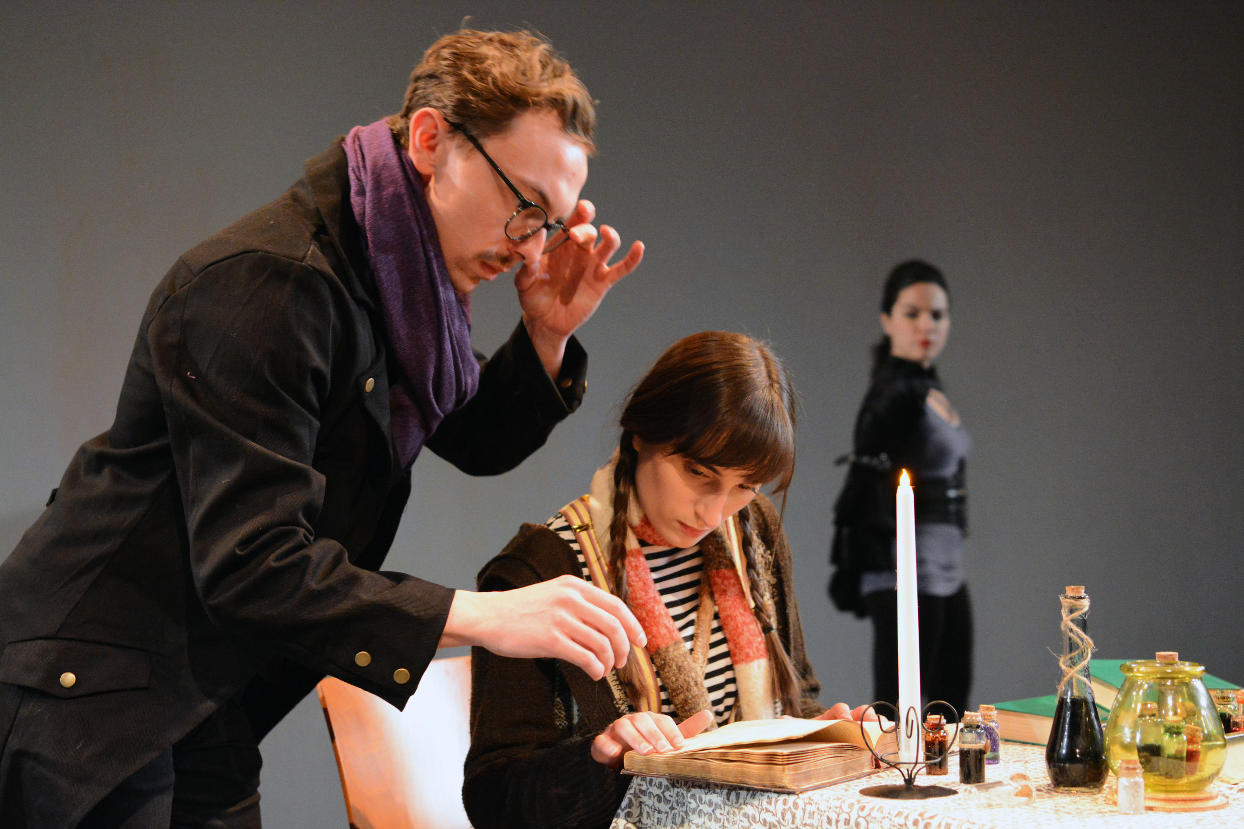 Press photos @ Dixon Place, featuring Brian Knoebel as Professor Schwartz, Jennifer Paldino as Isidora, and Justine Magnusson as Prime Minister